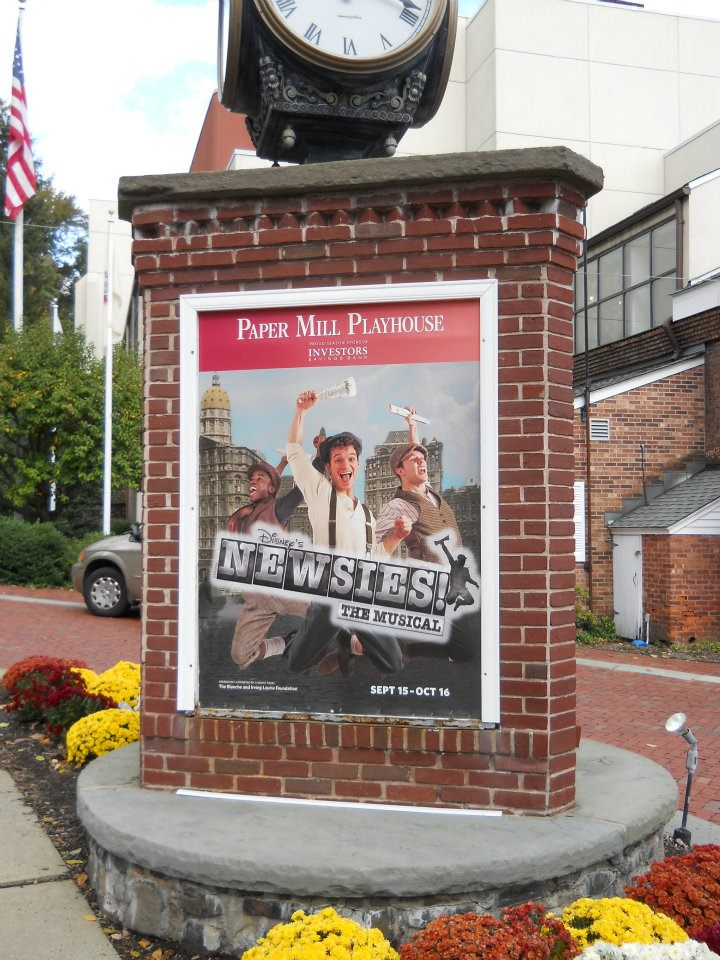 The Newsies sign outside of the Paper Mill Playhouse