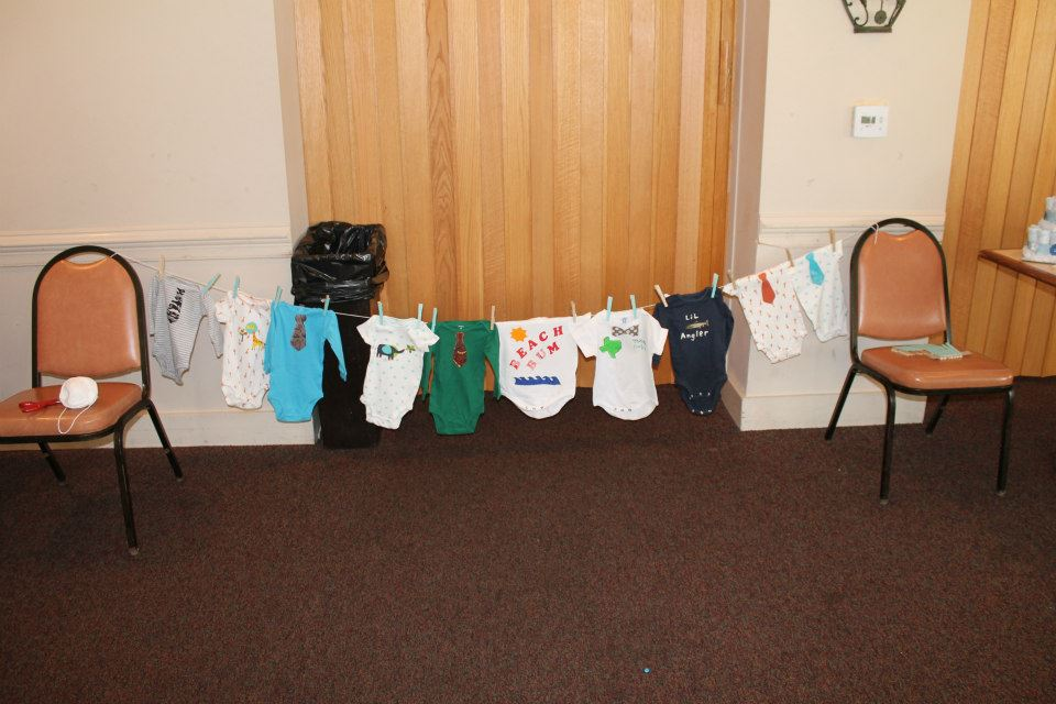 Some of the adorable and creative onesies that my shower guests made for Tex and Virg!